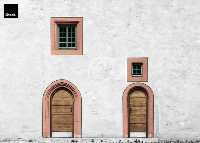 White Wall with doors and windows in Germany (historic plaster-facade).