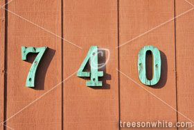 Wooden fence with house number 740